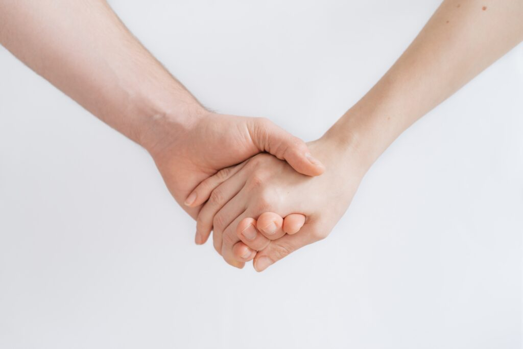 a photograph by roman kraft of two caucasian forearms with hands holding each other